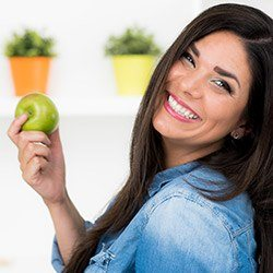 Smiling woman holding an apple
