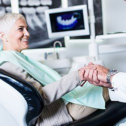 Woman shaking hands with dentist