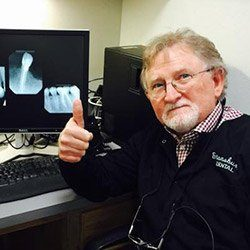 Dr. Stansbury using advanced dental technology