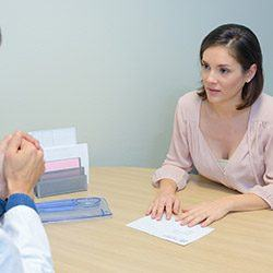 Woman in consultation room with dentist