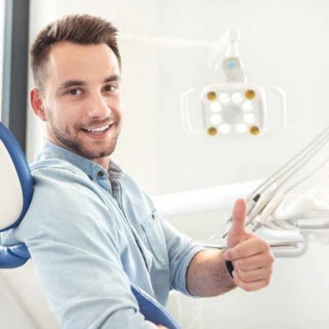 man giving thumbs up before getting tooth-colored fillings in Tyler