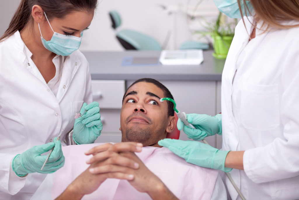 Fearful man in dental chair