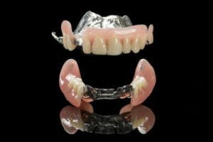 partial dentures on a dark background
