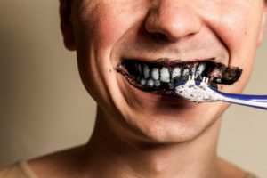 brushing teeth with charcoal