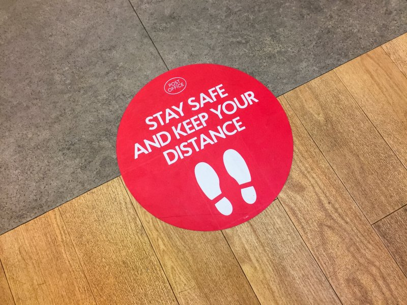 A social distancing sticker placed on the floor.