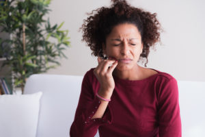 Woman needs to see her dentist to regain healthy gums