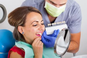 cosmetic dentist in tyler discussing porcelain veneers with a patient