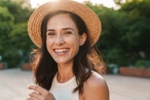 Woman smiling with dental implants while outside